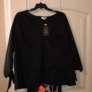 Black shirt with sleeve tie detail